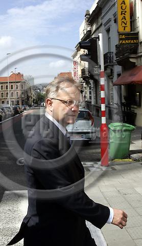 BRUSSELS - BELGIUM -16 AUGUST 2006 --Mr. Olli REHN, the Finnish EU-Commissioner for Enlargement walking accross a street. --PHOTO: JUHA ROININEN / EUP-IMAGES
