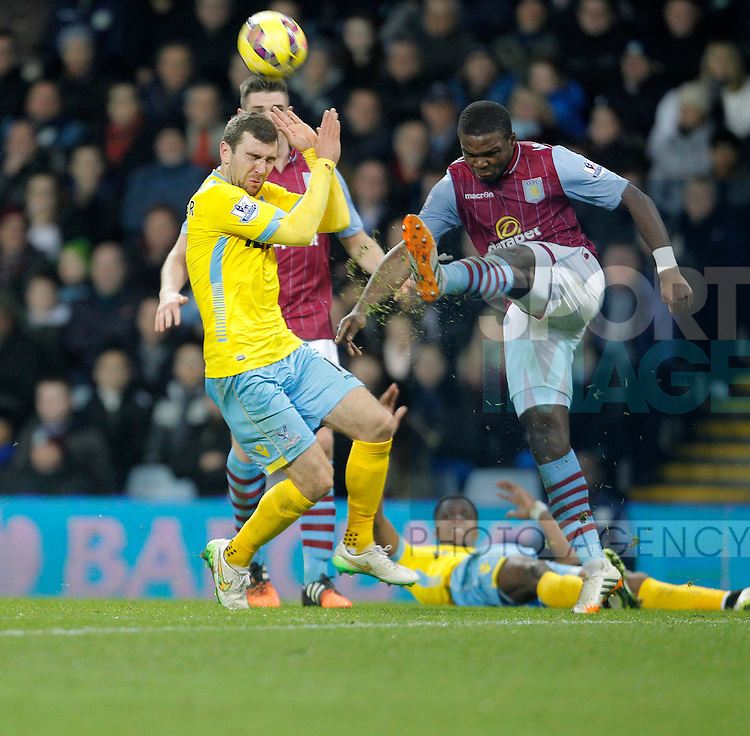 Jores Okore of Aston Villa clears the ball ahead of James McArthur of Palace - Barclays Premiership Football - Aston Villa v Crystal Palace - Villa Park  Birmingham - Season 14/15 - 01/01/2015 <br /> Photo: Malcolm Couzens/Sportimage