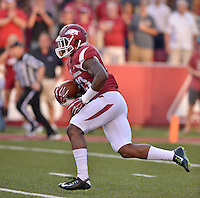STAFF PHOTO BEN GOFF  @NWABenGoff -- 09/20/14 <br /> Arkansas' Korliss Marshall returns the opening kickoff for a touchdown during the first quarter of the game against Northern Illinois in Reynolds Razorback Stadium in Fayetteville on Saturday September 20, 2014.