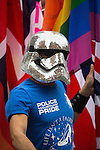© Joel Goodman - 07973 332324 . 27/08/2016 . Manchester , UK . A man wearing wearing a glitter ball Storm Trooper helmet and Police With Pride T-shirt . Annual Pride Parade through Manchester City Centre as part of Manchester Gay Pride's Big Weekend . Photo credit : Joel Goodman