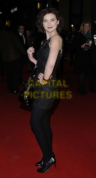"Natasha Leigh.attended the ""Arbitrage"" UK film premiere, Odeon West End cinema, Leicester Square, London, England, UK, February 20th 2013..full length black lace dress bag patent hand on hip  side .CAP/CAN.©Can Nguyen/Capital Pictures."