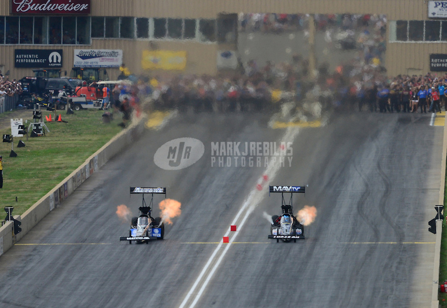Jul, 22, 2012; Morrison, CO, USA: NHRA top fuel dragster driver Antron Brown (left) races alongside Brandon Bernstein in the final round of the Mile High Nationals at Bandimere Speedway. Mandatory Credit: Mark J. Rebilas-US PRESSWIRE