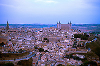 View of Toledo at dusk from the Parador de Toledo. Paradores are a chain of upscale hotels operated by the Spanish government. Cathedral tower at left, El Alcazar at right. Toledo Castilla-La Mancha Spain.
