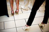 Models stand backstage with new shoe styles before beginning the Macy's Runway Fashion Show at La Plaza Mall in McAllen, Texas, Saturday, April 3, 2010. Stores within the La Plaza Mall have done well throughout the economic crisis due to its proximity to Mexico and the influx of Mexican tourists who purchase goods to bring back home. ...PHOTO/ Matt Nager