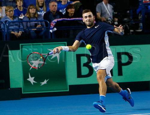 04.03.2016. Barclaycard Arena, Birmingham, England. Davis Cup Tennis World Group First Round. Great Britain versus Japan. Dan Evans of Great Britain hits a forehand during his singles match against Japan's Kei Nishikori on day 1 of the tie. Nishikori won in straight sets 6-3, 7-5, 7-6.