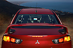 Straight rear view of a 2009 Mitsubishi Lancer Evolution MR at a Malibu California lookout point. Photo taken at dusk.
