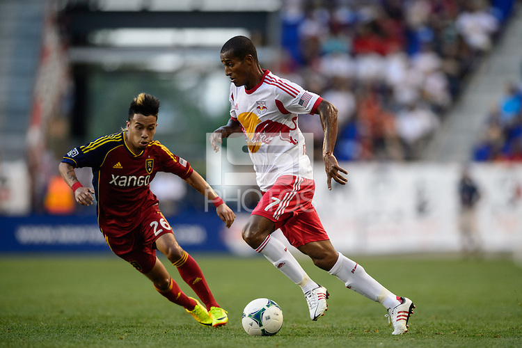 Roy Miller (7) of the New York Red Bulls is marked by Sebastian Velasquez (26) of Real Salt Lake. The New York Red Bulls defeated Real Salt Lake 4-3 during a Major League Soccer (MLS) match at Red Bull Arena in Harrison, NJ, on July 27, 2013.
