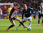 David Brooks of Sheffield Utd tackled by George Saville of Millwall  during the championship match at the Bramall Lane Stadium, Sheffield. Picture date 14th April 2018. Picture credit should read: Simon Bellis/Sportimage