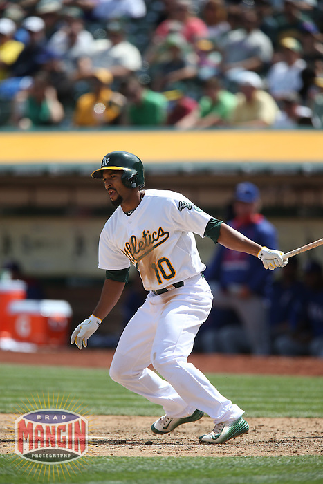 OAKLAND, CA - APRIL 9:  Marcus Semien #10 of the Oakland Athletics bats against the Texas Rangers during the game at O.co Coliseum on Thursday, April 9, 2015 in Oakland, California. Photo by Brad Mangin