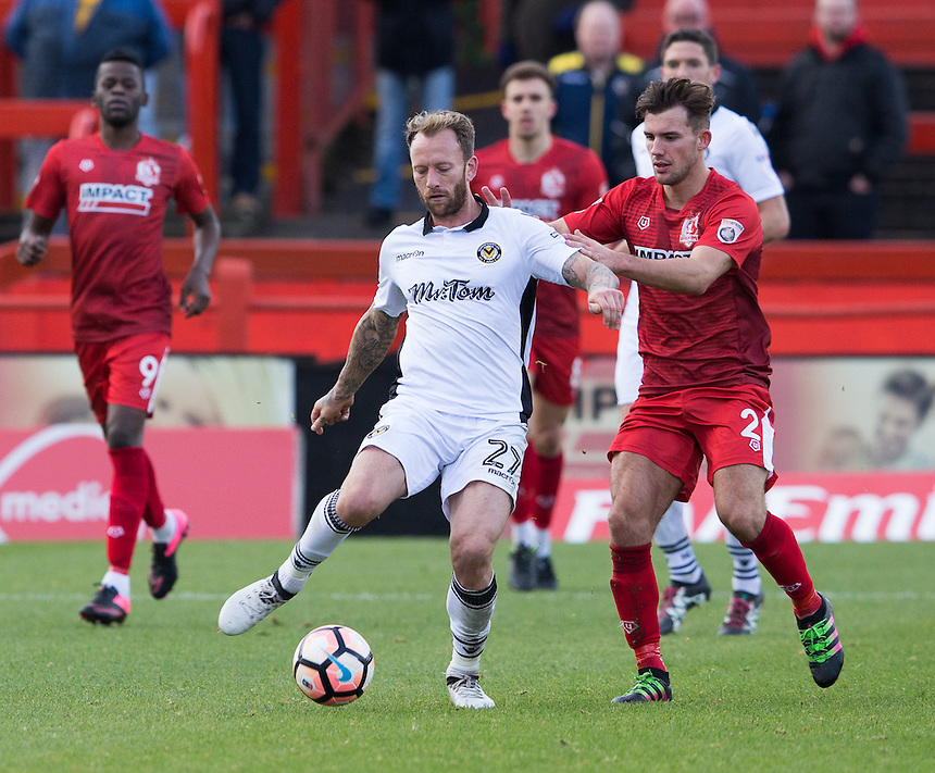 Sean Rigg of Newport County under pressure from Ryan Wilson of Alfreton Town<br /> <br /> Photographer James Williamson/CameraSport<br /> <br /> The Emirates FA Cup First Round - Alfreton Town v Newport County - Sunday 6th November 2016 - North Street - Alfreton<br />  <br /> World Copyright &copy; 2016 CameraSport. All rights reserved. 43 Linden Ave. Countesthorpe. Leicester. England. LE8 5PG - Tel: +44 (0) 116 277 4147 - admin@camerasport.com - www.camerasport.com