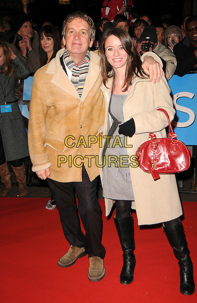 """FRANK SKINNER & RACHEL MASON .World Premiere of """"Yes Man"""" at the Vue Cinema, Leicester Square, London, England, December 9th 2008..full length brown beige sheepskin jacket coat striped scarf red bag jeans grey gray dress gloves .CAP/CAS.©Bob Cass/Capital Pictures"""