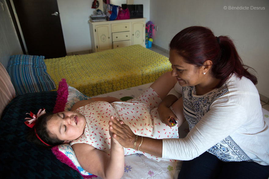 "Ana Ximena Navarro (L) is pictured playing with her aunt Gabriela Rios Ballesteros (R), at her home in Guadalajara, Mexico on February 22, 2017. Ximena was diagnosed as an infant with Hurler syndrome. Hurler syndrome is the most severe form of mucopolysaccharidosis type 1 (MPS1), a rare lysosomal storage disease, characterized by skeletal abnormalities, cognitive impairment, heart disease, respiratory problems, enlarged liver and spleen, characteristic facies and reduced life expectancy. Ximena was being given enzyme replacement therapy (ERT) when she was 19 months old, and she was suddenly able to eat and sleep. She is now 12, and has normal hormonal development for her age, although some mental delay, according to her father. ""Without the treatment, she would have died from all the complications — untreated, children have a very bad quality of life and typically die before they are seven"", her father says. Photo credit: Bénédicte Desrus"