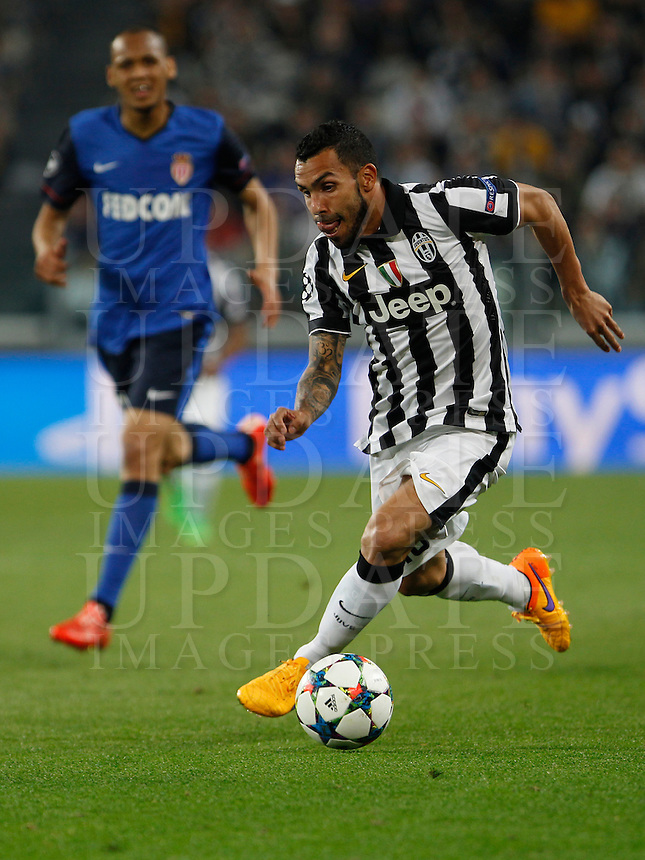 Calcio, quarti di finale di andata di Champions League: Juventus vs Monaco. Torino, Juventus stadium, 14 aprile 2015.<br /> Juventus' Carlos Tevez in action during the Champions League quarterfinals first leg football match between Juventus and Monaco at Juventus stadium, 14 April 2015.<br /> UPDATE IMAGES PRESS/Isabella Bonotto