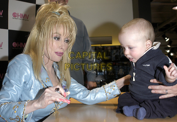 """DOLLY PARTON.signs copies of her new album """"Halos and Horns"""" at HMV.www.capitalpictures.com.sales@capitalpictures.com.© Capital Pictures"""