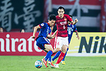 Suwon Midfielder Kim Jongwoo (L) plays against Guangzhou Defender Feng Xiaoting (R) during the AFC Champions League 2017 Group G match between Guangzhou Evergrande FC (CHN) vs Suwon Samsung Bluewings (KOR) at the Tianhe Stadium on 09 May 2017 in Guangzhou, China. Photo by Yu Chun Christopher Wong / Power Sport Images