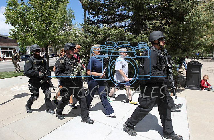 Officers from around the state run the memorial baton into the 15th annual Nevada Law Enforcement Officers Memorial ceremony in Carson City, Nev., on Thursday, May 3, 2012..Photo by Cathleen Allison