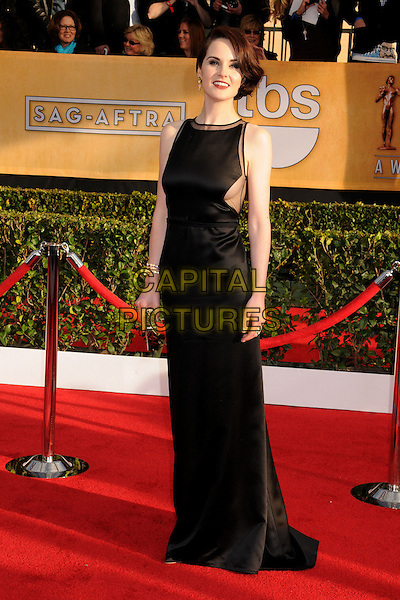 Michelle Dockery (wearing Ralph Rucci).Arrivals at the 19th Annual Screen Actors Guild Awards at the Shrine Auditorium in Los Angeles, California, USA..27th January 2013.SAG SAGs full length black sleeveless dress side boob cleavage .CAP/ADM/BP.©Byron Purvis/AdMedia/Capital Pictures