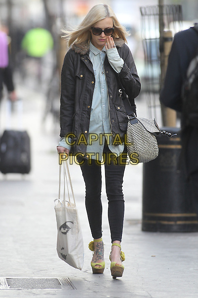 Fearne Cotton in central London, London, England..April 2nd, 2012.full length blue shirt black leggings jacket sunglasses shades grey gray bag purse yellow platform peep toe shoes zig zag white hand looking down.CAP/HIL.©John Hillcoat/Capital Pictures .