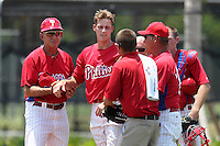 GCL Phillies Craig Fritsch #49 is helped by Rolano de Armas trainers and Les Lancaster after getting hit in the head by a line drive during a game against the GCL Braves at the Carpenter Complex on June 22, 2011 in Clearwater, Florida.  The Braves defeated the Phillies 8-6.  (Mike Janes/Four Seam Images)