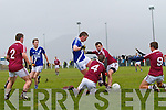 Daniel Daly for St Mary's is denied a goal opportunity as Dromid men Donal Ó Suilleabháin and  Caoimhín Ó Sé throw themselves on the ball.