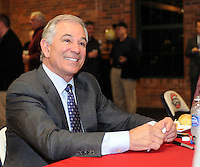 New Boston Red Sox manager Bobby Valentine signs autographs for fans on January 23, 2012, at the annual Greenville Drive Hot Stove Event in Greenville, South Carolina. (Tom Priddy/Four Seam Images)