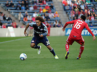 New England defender Kevin Alston (30) drives past Chicago midfielder Marco Pappa (16).  The Chicago Fire defeated the New England Revolution 3-2 at Toyota Park in Bridgeview, IL on Sept. 25, 2011.