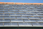 Close up of photovoltaic roof tiles on building, Kynance Cove, Cornwall, England, UK