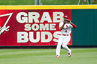 Thomas Pham (4) of the Springfield Cardinals catches a fly ball to center field during a game against the Arkansas Travelers on May 10, 2011 at Hammons Field in Springfield, Missouri.  Photo By David Welker/Four Seam Images.