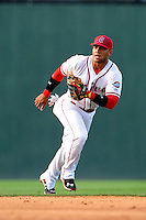 Second baseman Yoan Moncada (24) of the Greenville Drive plays the infield in a game against the Savannah Sand Gnats on Sunday, July 5, 2015, at Fluor Field at the West End in Greenville, South Carolina. The Cuban-born 19-year-old Red Sox signee has been ranked the No. 1 international prospect in baseball by Baseball America. Savannah won, 8-6. (Tom Priddy/Four Seam Images)
