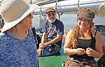 Diane Bethune of Saugerties talking with Sloop Clearwater's First Mate, Aleythea Dolstad, overseeing the Sloop's Pumpkin Sail stop at Hudson, NY on Monday, October 10, 2011. Photo by Jim Peppler. Copyright Jim Peppler/2011.