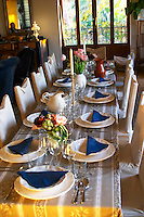 The dining room table decorated and set with flowers and decorative vegetables for dinner guests. Clos des Iles Chambres d'Hotes Bed and Breakfast Le Brusc Six Fours Cote d'Azur Var France