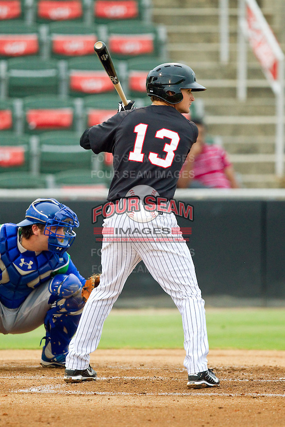 Jake Brown (13) of the Kannapolis Intimidators at bat against the Lexington Legends at CMC-Northeast Stadium on July 30, 2013 in Kannapolis, North Carolina.  The Legends defeated the Intimidators 1-0.  (Brian Westerholt/Four Seam Images)