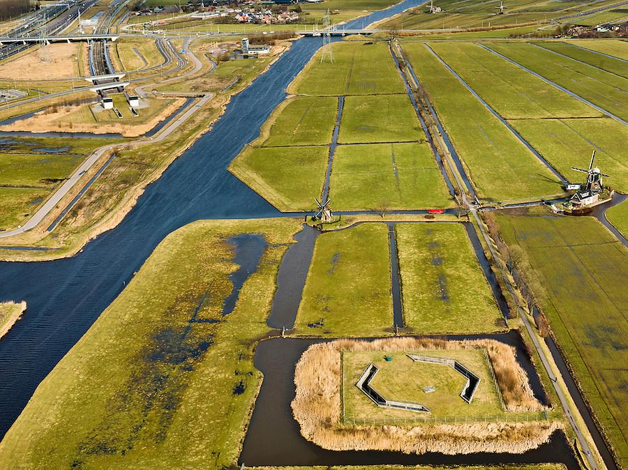 Nederland, Zuid-Holland, Gemeente Leiderdorp, 20-02-2012; Polder Achthoven met zicht op de ingang van de boortunnel onder het Groene Hart van de hogesnelheidslijn (HSL-Zuid), met bedieningsgebouw van de tunnel, voorbeeld 'landschappelijke inpassing'. Onder in beeld luchtschacht van de tunnel die de drukgolf van de treinen opvangt. In de polder verder twee watermolens..View of  Polder Achthoven with entrance to the drilled tunnel of the High Speed Line (HSL) under so-called the Green Heart, with the control building of the tunnel, example of 'landscaping'..Bottom of the screen the air shaft of the tunnel that enables the pressure wave of the trains to escape..luchtfoto (toeslag), aerial photo (additional fee required).copyright foto/photo Siebe Swart