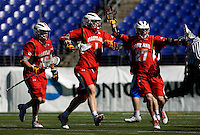 Dean Hart (16) of Maryland celebrates with teammates Grant Catalino (1) and Ryan Young (27) during the Face-Off Classic in at M&T Stadium in Baltimore, MD