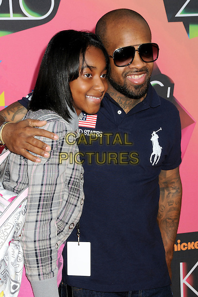 GUEST & JERMAINE DUPRI .at the 23rd Annual Nickelodeon Kids' Choice Awards 2010 held at Pauley Pavilion in Westwood, California, USA, March 27th 2010 .arrivals kids half length sunglasses jeans navy blue t-shirt arm around smiling beard facial hair tattoos .CAP/ADM/BP.©Byron Purvis/Admedia/Capital Pictures