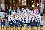 Pupils of Gaelscoil Easmainn Tralee who made their First Hol;y Communion on Saturday in St John's church,Tralee with the pupils are, Emma Ní Chiomnaith (Muinteoir) Caith Uí Chonchuir (Principal),Fr Francis Nolan and Cáit Uí Lunaigh (SN Teacher)