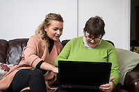 FAO: Society <br /> Pictured L-R: Alys Phillips and resident Sharon Wieland use a laptop<br /> Re: Care worker Alys Phillips, 23, who looks after people with learning disabilities in Brecon, mid Wales, UK. Wednesday 01 February 2017