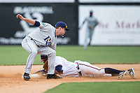 Derian Cruz (7) of the Danville Braves is tagged out by Justin Bridgman (3) of the Princeton Rays as he tries to steal second base at American Legion Post 325 Field on June 25, 2017 in Danville, Virginia.  The Braves walked-off the Rays 7-6 in 11 innings.  (Brian Westerholt/Four Seam Images)