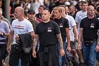 """Ueber 1.000 Rechtsextreme aus mehreren Bundeslaendern demonstrieren am Samstag den 19. August 2017 in Berlin zum Gedenken an den Hitler-Stellvertreter Rudolf Hess.<br /> Rudolf Hess hatte am 17. August 1987 im Alliierten Kriegsverbrechergefaengnis in Berlin Spandau Selbstmord begangen. Seitdem marschieren Rechtsextremisten am Wochenende nach dem Todestag mit sog. """"Hess-Maerschen"""".<br /> Weit ueber 1.000 Menschen protestierten gegen den Aufmarsch der Rechtsextremisten und stoppten den Hess-Marsch nach 300 Metern u.a. mit Sitzblockaden. Der rechtsextreme Aufmarsch wurde daraufhin von der Polizei umgeleitet.<br /> Aus dem Aufmarsch wurden mehrfach Gegendemonstranten angegriffen, mindestens ein Neonazi wurde festgenommen.<br /> Im Bild: Rechtsextremisten des Kameradschaftsbund Anklam (KBA). Derr (KBA) ist eine der aeltesten Kameradschaften in Mecklenburg-Vorpommern, deren Mitglieder z.T. schon in der DDR als Rechtsextreme zusammen organisiert waren.<br /> 19.8.2017, Berlin<br /> Copyright: Christian-Ditsch.de<br /> [Inhaltsveraendernde Manipulation des Fotos nur nach ausdruecklicher Genehmigung des Fotografen. Vereinbarungen ueber Abtretung von Persoenlichkeitsrechten/Model Release der abgebildeten Person/Personen liegen nicht vor. NO MODEL RELEASE! Nur fuer Redaktionelle Zwecke. Don't publish without copyright Christian-Ditsch.de, Veroeffentlichung nur mit Fotografennennung, sowie gegen Honorar, MwSt. und Beleg. Konto: I N G - D i B a, IBAN DE58500105175400192269, BIC INGDDEFFXXX, Kontakt: post@christian-ditsch.de<br /> Bei der Bearbeitung der Dateiinformationen darf die Urheberkennzeichnung in den EXIF- und  IPTC-Daten nicht entfernt werden, diese sind in digitalen Medien nach §95c UrhG rechtlich geschuetzt. Der Urhebervermerk wird gemaess §13 UrhG verlangt.]"""