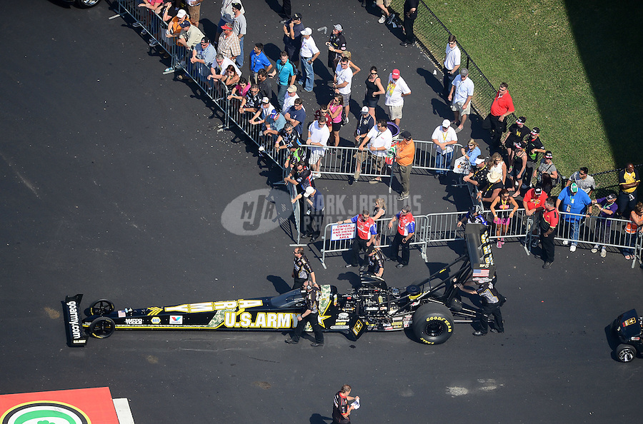 Apr. 28, 2012; Baytown, TX, USA: Aerial view of NHRA crew members for top fuel dragster driver Tony Schumacher during qualifying for the Spring Nationals at Royal Purple Raceway. Mandatory Credit: Mark J. Rebilas-