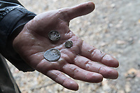 Archeologists work dig up ancient coins from the dried out riverbed of river Danube at a record low level for days near Erd (about 20 kilometres South-West of capital city Budapest), Hungary on Oct. 25, 2018. ATTILA VOLGYI