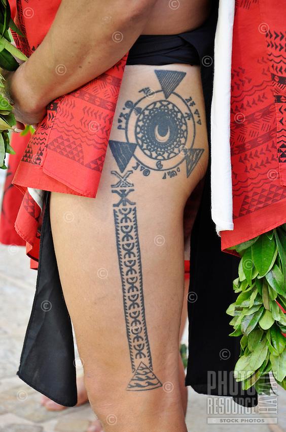 A Hawaiian man wearing a malo or loincloth sports a tattoo on his thigh.