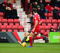 Lincoln City's Shay McCartan vies for possession with  Swindon Town's Dion Conroy<br /> <br /> Photographer Andrew Vaughan/CameraSport<br /> <br /> The EFL Sky Bet League Two - Swindon Town v Lincoln City - Saturday 12th January 2019 - County Ground - Swindon<br /> <br /> World Copyright &copy; 2019 CameraSport. All rights reserved. 43 Linden Ave. Countesthorpe. Leicester. England. LE8 5PG - Tel: +44 (0) 116 277 4147 - admin@camerasport.com - www.camerasport.com