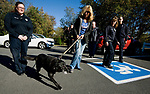 WOLCOTT, CT-101117JS02-- Lily, a 17-year old retired state police narcotics dog, is escorted to the Wolcott Veterinary Clinic in Wolcott by her owner Debra Agosto Threlfall, center, and assistant animal control officer Dana Natrillo, left, and animal control officer Roslyn Nenninger, right, on Thursday to be put to sleep due to health issues. Wolcott police officers were on hand to offer a farewell salute. <br /> Jim Shannon Republican-American