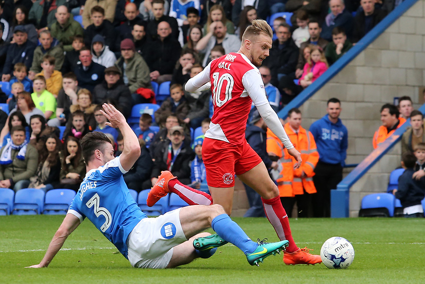 Fleetwood Town's David Ball rides the challenge of Peterborough United's Andrew Hughes<br /> <br /> Photographer David Shipman/CameraSport<br /> <br /> The EFL Sky Bet League One - Peterborough United v Fleetwood Town - Friday 14th April 2016 - ABAX Stadium  - Peterborough<br /> <br /> World Copyright &copy; 2017 CameraSport. All rights reserved. 43 Linden Ave. Countesthorpe. Leicester. England. LE8 5PG - Tel: +44 (0) 116 277 4147 - admin@camerasport.com - www.camerasport.com