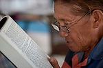 A woman reads the Bible during a workshop in St. Ignatius, Guyana, to help laypersons improve their reading of the Sunday scriptures in their own languages, so they can better lead liturgies in their own indigenous communities.