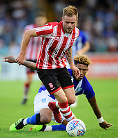 Lincoln City trialist vies for possession with Sheffield Wednesday's Liam Palmer<br /> <br /> Photographer Chris Vaughan/CameraSport<br /> <br /> Football Pre-Season Friendly - Lincoln City v Sheffield Wednesday - Friday 13th July 2018 - Sincil Bank - Lincoln<br /> <br /> World Copyright &copy; 2018 CameraSport. All rights reserved. 43 Linden Ave. Countesthorpe. Leicester. England. LE8 5PG - Tel: +44 (0) 116 277 4147 - admin@camerasport.com - www.camerasport.com