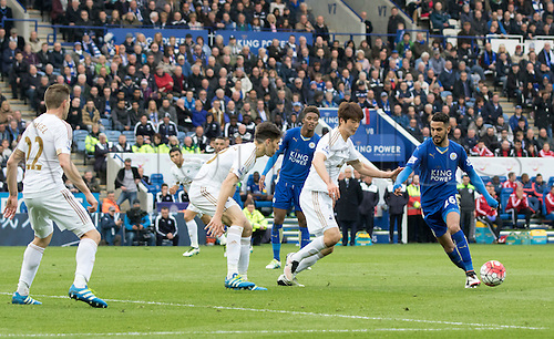 24.04.2016. King Power Stadium, Leicester, England. Barclays Premier League. Leicester versus Swansea.  Leicester City midfielder Riyad Mahrez on the attack with the ball closely watched by the Swansea players.