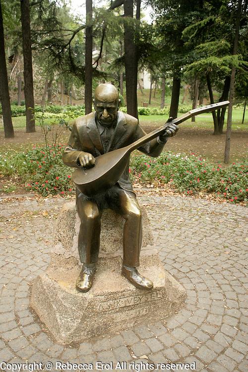 Statue of Asik Veysel, famous Turkish baglama player, in Gulhane Park, Istanbul, Turkey