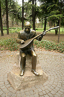 Statue of Asik Veysel, famous Turkish baglama player, in Gulhane Park, Istanbul, Turkey